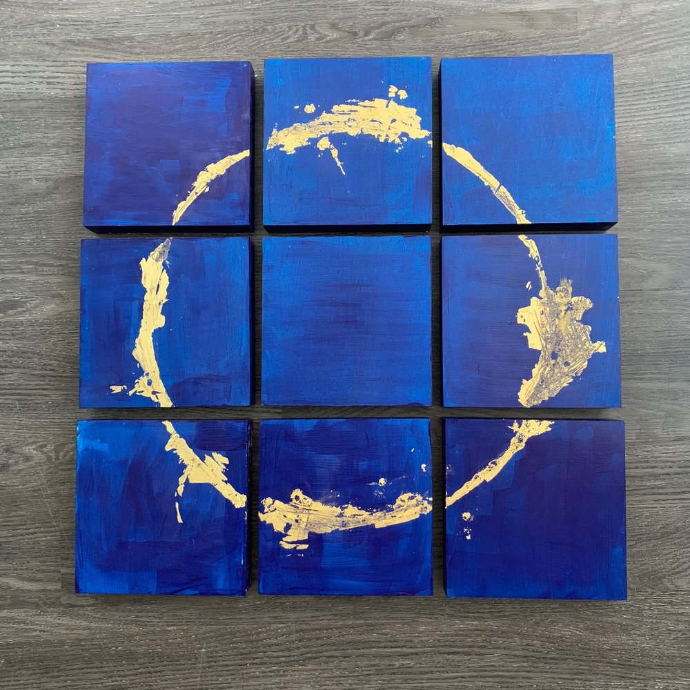 "- EclipseThis is the first of a new series of paintings focusing on motherhood, the moon cycles and how it pulls the tide, the sun / my son, the ocean and the reflection of the ocean in the sky…the connection between all things. push/pull. the depths of emotions that are as deep as the ocean floor and as intense as the sun that burns our eyes. One moment holds all of these elements.$900 holiday price $700SOLDLove Bomb pricing available through Friday, November 25th.Details: 9 wood panels measuring 8x8x1.5"" eachPhthalo Blue acrylic paint and 23k gold leaf. love.Payment plans available. email support@catherinejust.com"