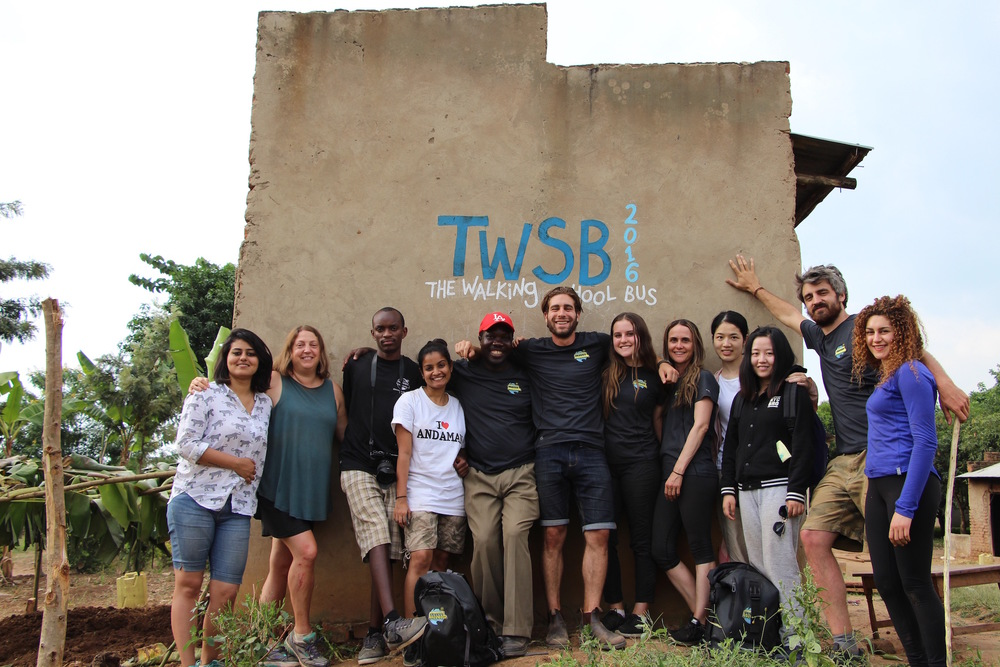 TWSB Team (from left to right) Sukriti, Lainie, Ally, Ruchi, Enosh (Head of Putti Village), Aaron, Samantha, Michelle, Shirley, Lynne, Leo, and Eli standing to the right of the garden we just planted.