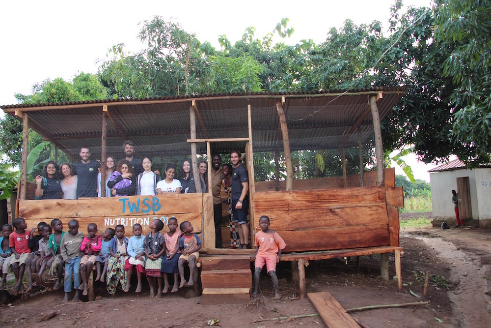 TWSB Team standing in front of the completed chicken coop!  This micro finance project provides students with nutrition (eggs), the school with passive income (extra eggs are sold), and sustains the CSA garden using chicken manure as fertilizer.