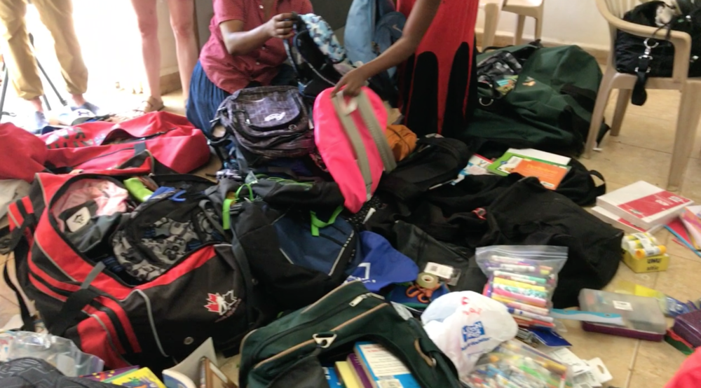 Sorting through backpacks, stationary, and clothing donated by the many generous families from Vancouver.