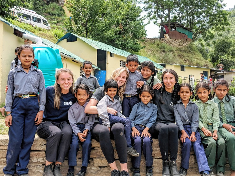 Members of The Walking School Bus's India 2018 Expedition with students who go to school with at our local partner school