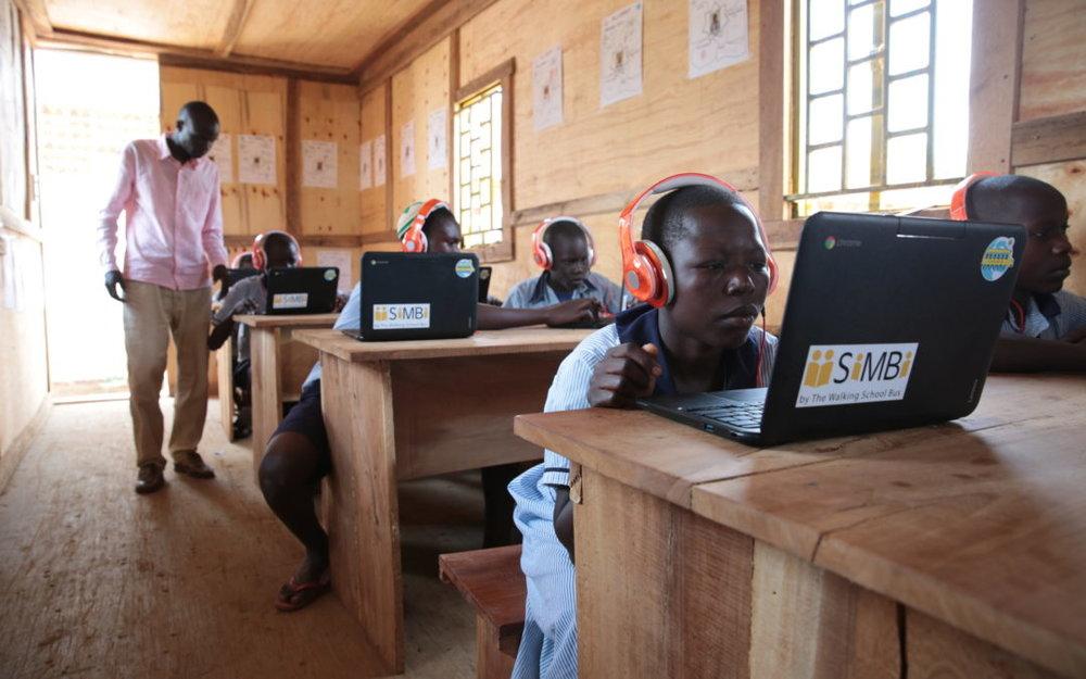 Students using Simbi at Jonathan Netanyahu School in Putti Village, Uganda