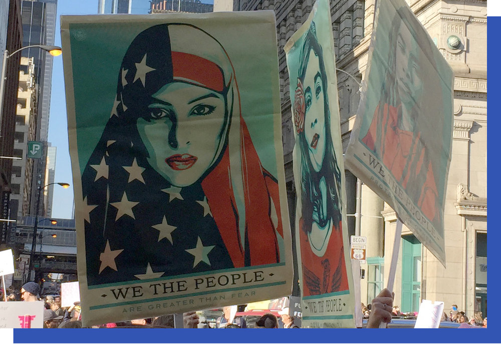 Lots of these powerful Shepard Fairey posters—that were printed in the  NY Times  and the  Washington Post  papers on Inauguration Day—were peppered throughout the crowd.