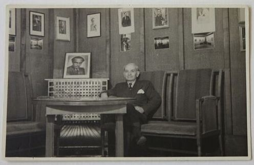 Wolf Kahan seated in Kahan Tailor's showroom designed by Adolf Loos in c.1930, Vienna, 1950. Kahan Family Collection.