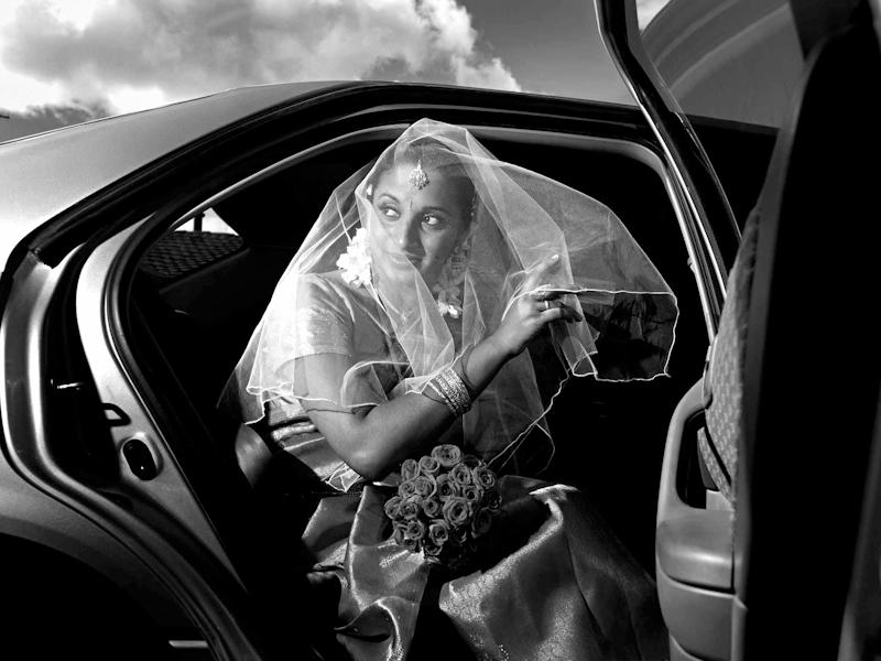 Indian bride arriving at wedding ceremony