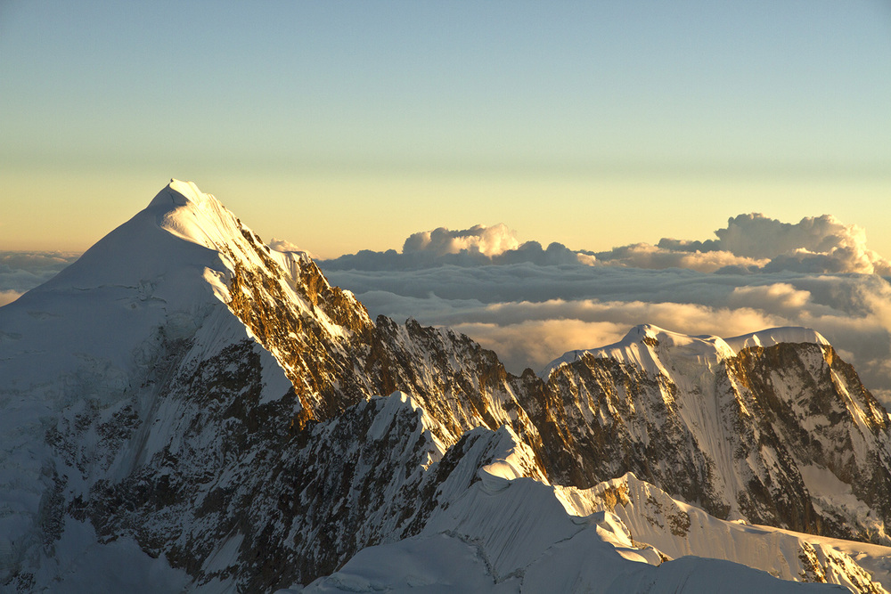 Illampu (6.360m/20,866ft.) during sunrise in the Cordillera Real, Bolivia. Shot taken from the summit of Ancohuma (6.427m/21,086ft).