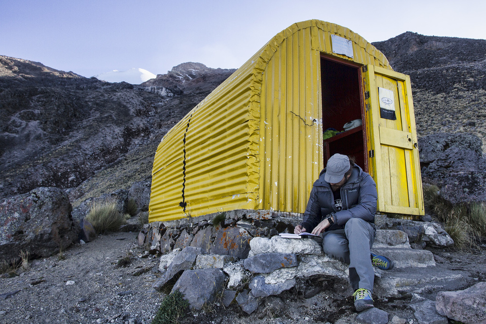 A couple hundred feet away from the  Piedra Grande  hut, a small, yellow tin shed hut sits amongst the car-sized boulders. The small space inside the hut is just large enough for the both of us and our gear.