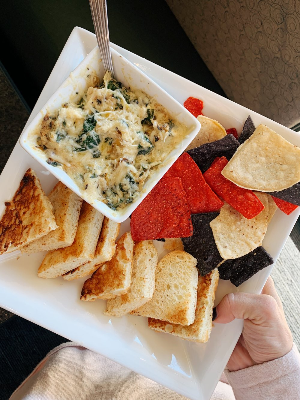 SPINACH AND ARTICHOKE DIP  Our homemade dip made with marinated artichoke hearts and baby spinach. Served with toasted ciabatta bread and tortilla chips.