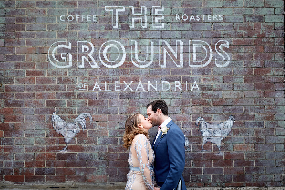 Bride and groom kiss at the grounds of Alexandria by blue mountains wedding photographer Joshua Witheford