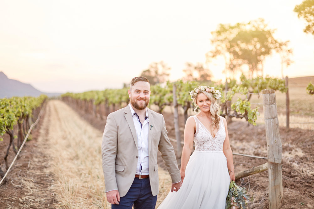 Bride and groom in vineyard at Estate Tuscany in the Hunter Valley during sunset by Blue Mountains wedding photographer Joshua Witheford