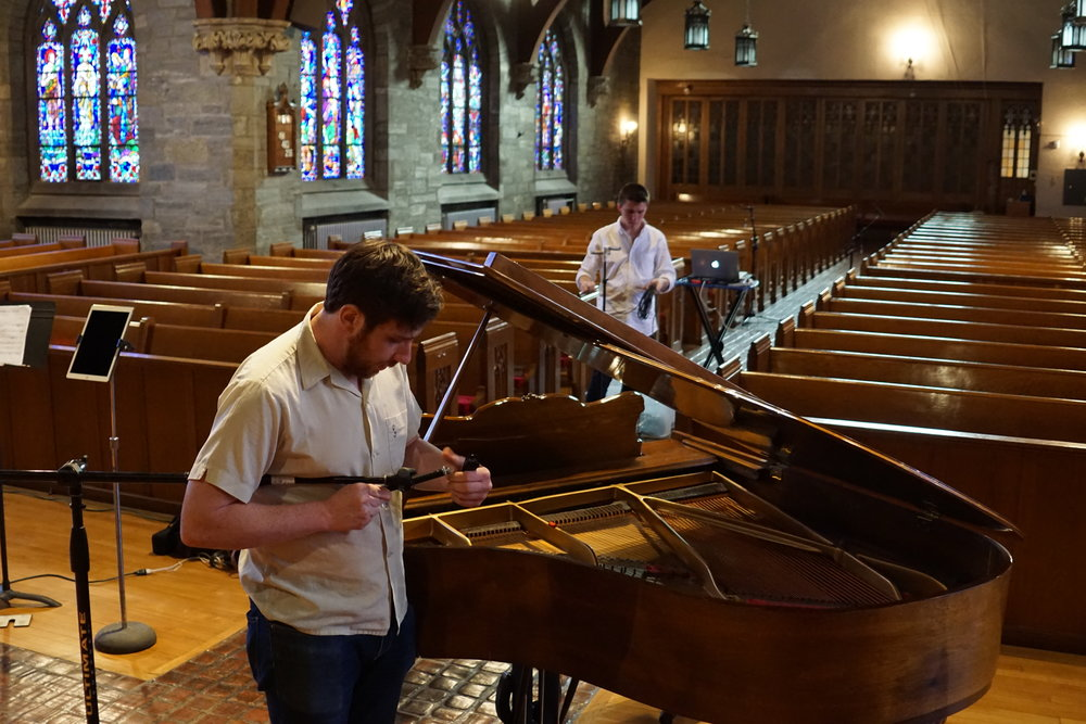 Sound engineer Drew Taurisano and intern Thomas Hagen setting up for the recording session at Carmel Presbyterian Church on June 1st.