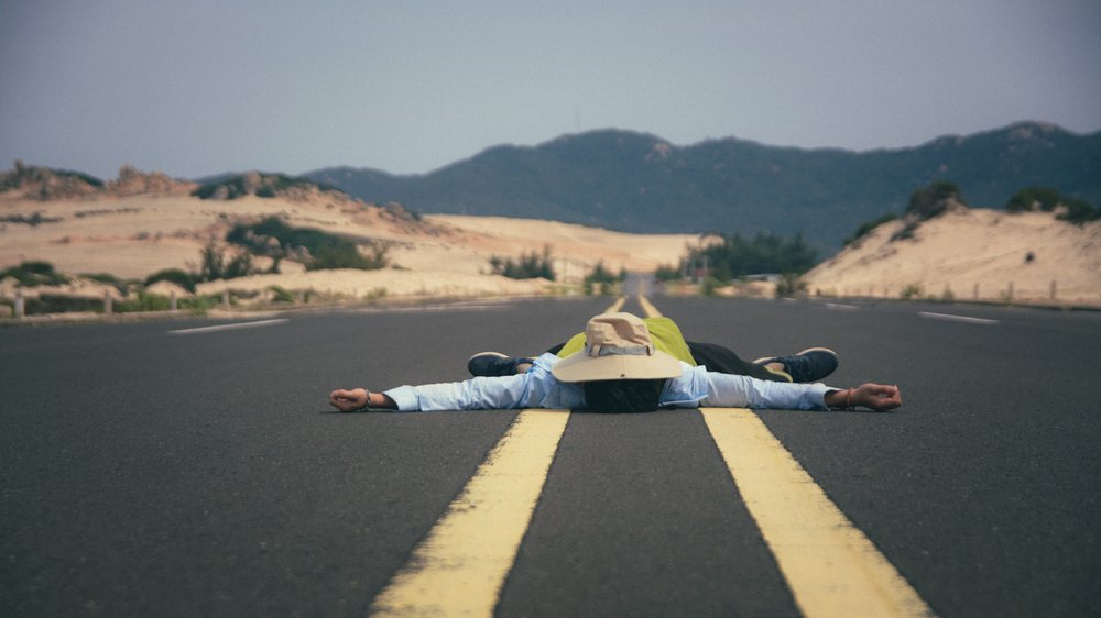 Laying in the middle of the road just doesn't cut it. Be patient, your ride will come!