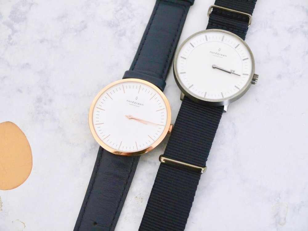 Nordgreen Copenhagen - 40mm Infinity in Rose Gold with Navy strap and Rose Gold hardware & 40mm Philosopher in Gunmetal w/ Navy Nylon strap with Gunmetal hardware.