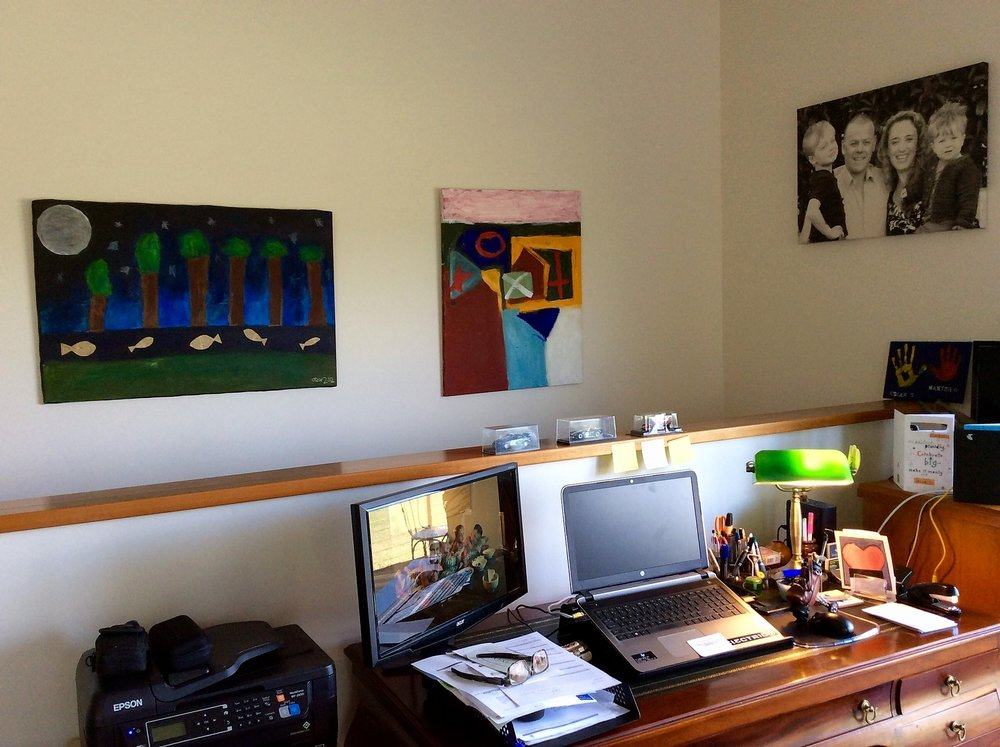 Our home office with the boys artworks displayed on the wall.
