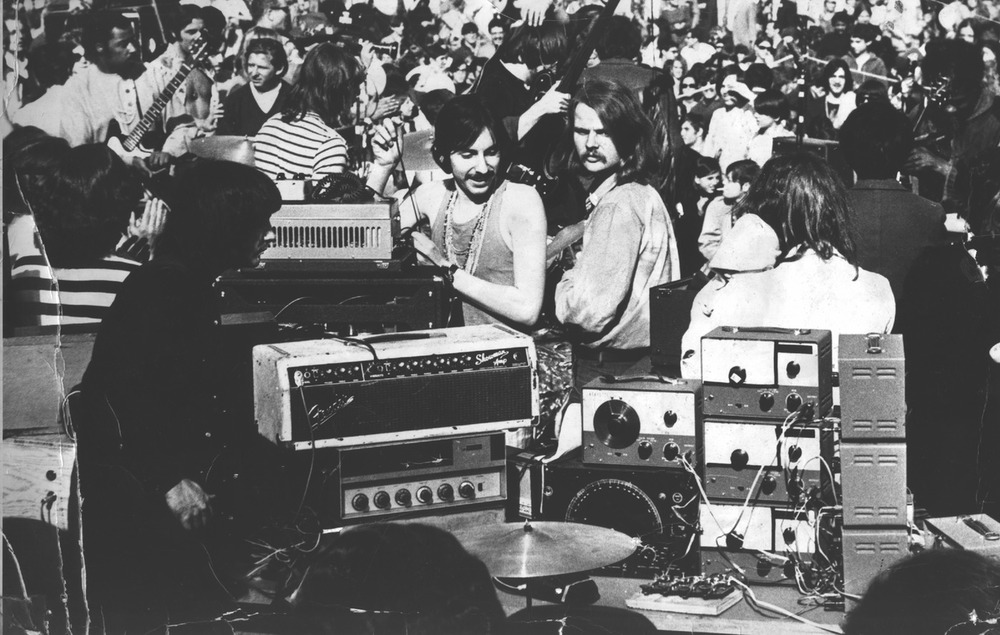 Formed in 1967 as an electronic rock duo featuring Dan Taylor on drums and Simeon on a homemade synthesizer consisting of 12 oscillators and an assortment of sound filters, telegraph keys, radio parts, lab gear and a variety of second hand electronic junk, the band quickly gained a reputation as New York's leading underground musical expression. The photo below is of the band's first gig, before 30,000 fans in NY's Central Park. First full-length album was released in 1968 on KAPP Records. The self titled album rode the Billboard Magazine Top 100 list for 10 weeks. The second full length album was released in 1969, titled CONTACT. A national tour was launched by the band's recording popularity. A third album was recorded in 1970, but not released when KAPP folded.Without a record label the band disbanded, and, except for an occasional bootleg release, was not heard from again until 1994, when a German label named TRC, without license, re-released the first two albums in a double CD version, complete with poster. Since then numerous artists around the world have released covers, tributes and samplings of Silver Apples material. In 1996, Simeon re-activated Silver Apples, recording and performing with many musician friends and admirers. On March 10, 2005, original drummer, Danny Taylor, passed away of a heart attack in Kingston, New York. He was 56 years old. Working as a solo performer, with Danny's drum sounds recreated by electronic means, Simeon has continued the Silver Apples live concerts with performances literally all over the world. Currently Simeon is still recording and performing as a solo.