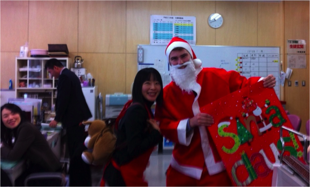 Mariko sensei and I bringing Christmas spirit at the high school I taught English at.