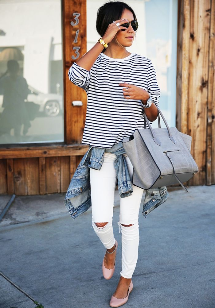 Casual and preppy. A black and white t-shirt is a great staple in any wardrobe. I love the fact that she has opted for a nude shoe and grey bag. This for me is more relaxed than having everything matching.