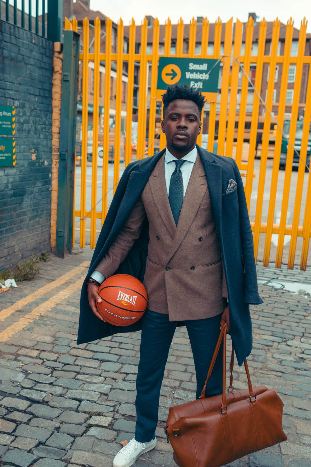 Javanandre-wearing-suit-holds-holdall-and-basketball