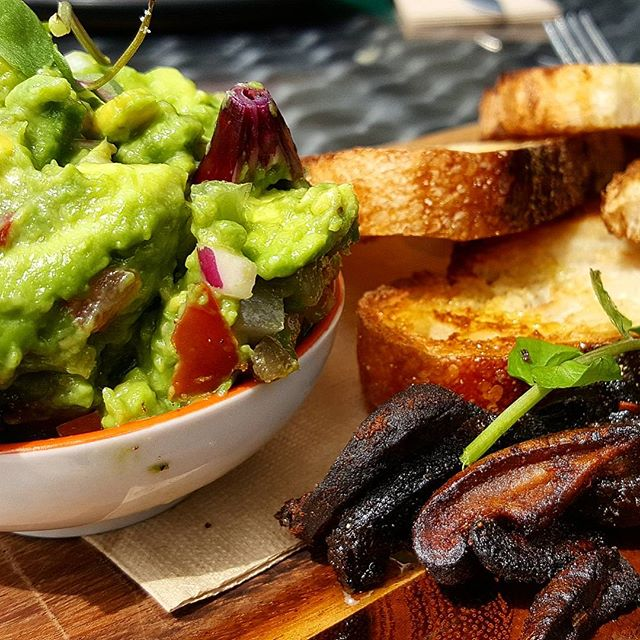 A mighty fine take on smashed avo, with a side of shiitake bacon, from @lordsofpour