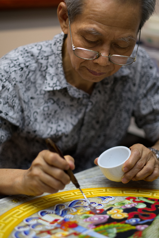 The Porcelain Painter - A porcelain glaze artist at Dafen Art Village.jpg