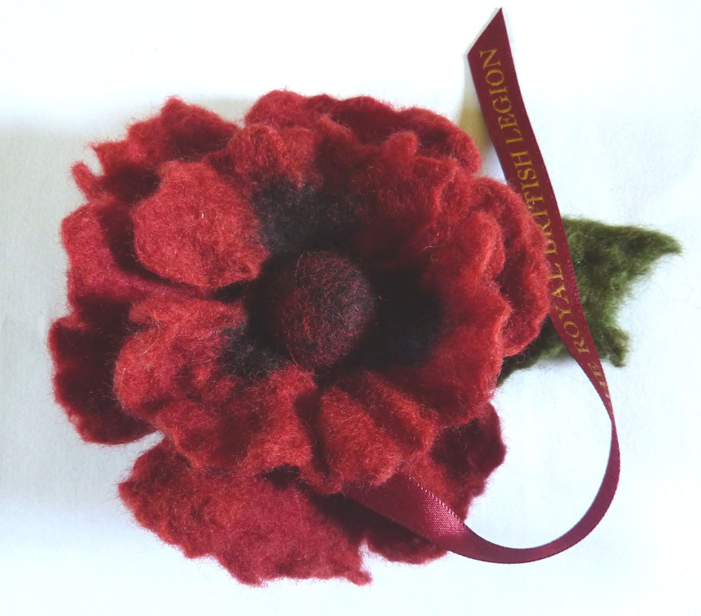 Royal British Legion poppy with leaf.JPG