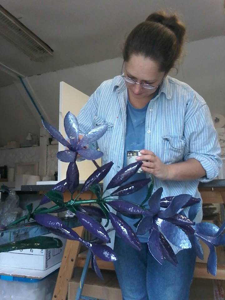 Alison Catchlove painting a finished sculpture.jpg