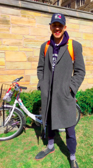 """J.T. Flowers PC '17 sporting a baseball hat, overcoat, and a brightly colored backpack and socks. He describes his style as """"Very Portland."""""""