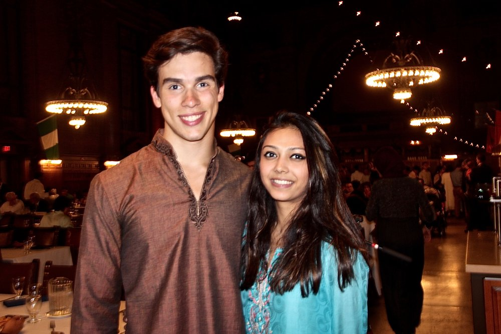 Nico Religa and Anya Malik complement each other in traditional Indian outfits.