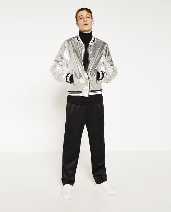 Source: Zara ZARA (The focus is not just the very outlandish silver bomber jacket, but also what it's paired with – color block kitsch with bold but silent hues like black, white, beige and a certain kind of green.)