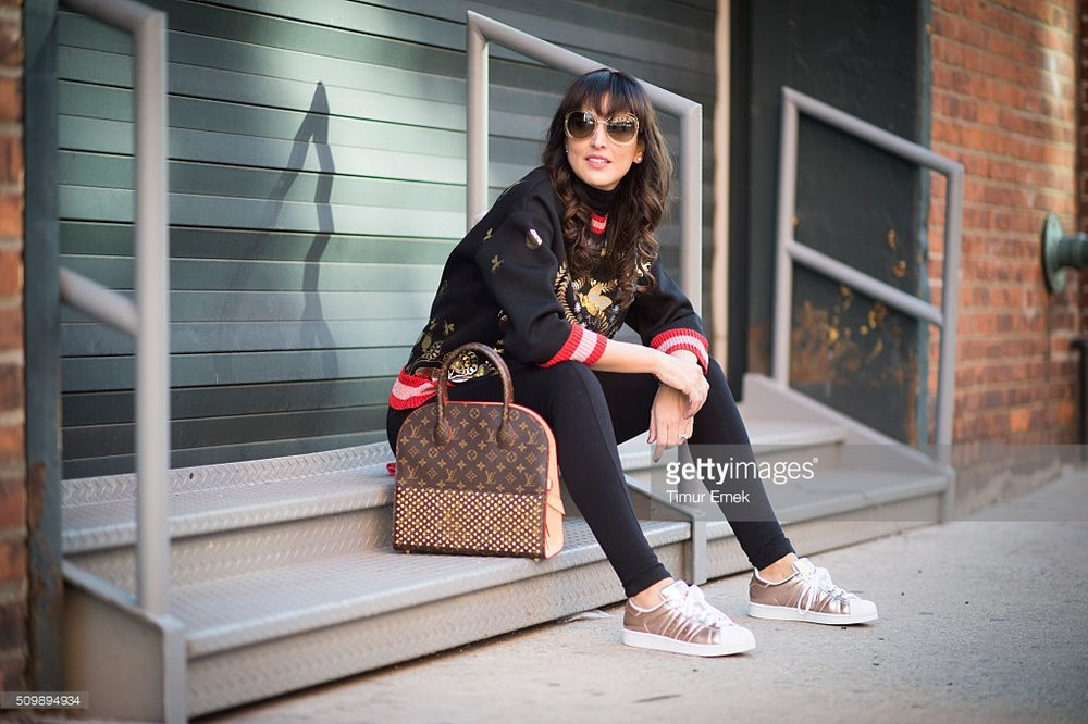 Source: Getty Images Gucci blouse w/ Adidas sneakers