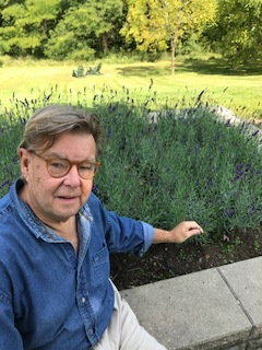 Here John is selecting lavender for a chocolate lavender cake he's hoping to make!  This bed, right outside our front door, makes for a heavenly scent!