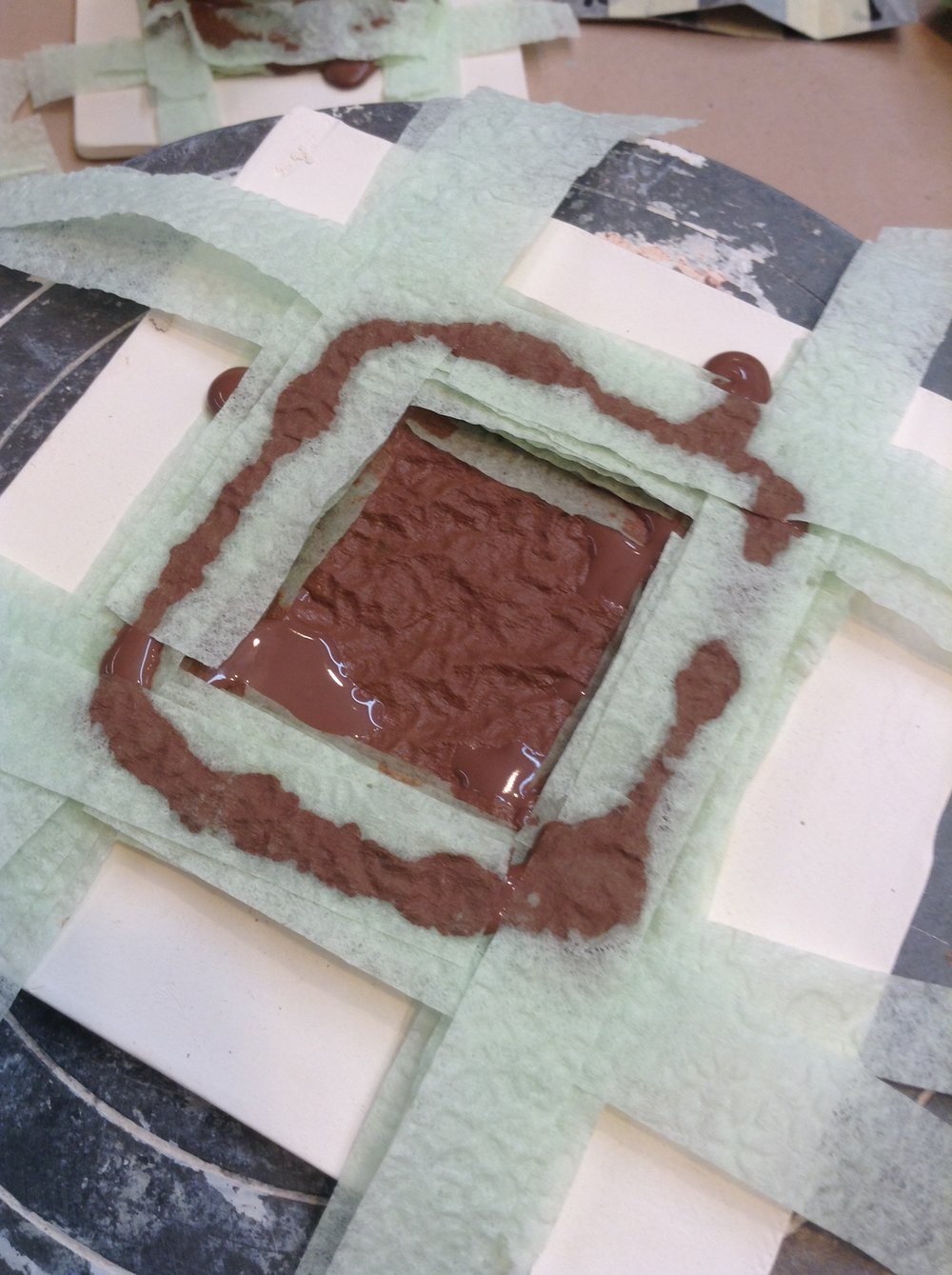 A few layers of square shaped pathway stacked on top of the solid base. Here the clay paths are supported by thin napkin strips because I wanted to find out if an open center would be easier to manage or would dry faster. Maybe, but the solid napkin square used as a layer is much faster. I'm particularly fond of the dimpled texture of the bottom layer that happens when the napkin embossing wrinkles up. (I can't prevent it anyway!)