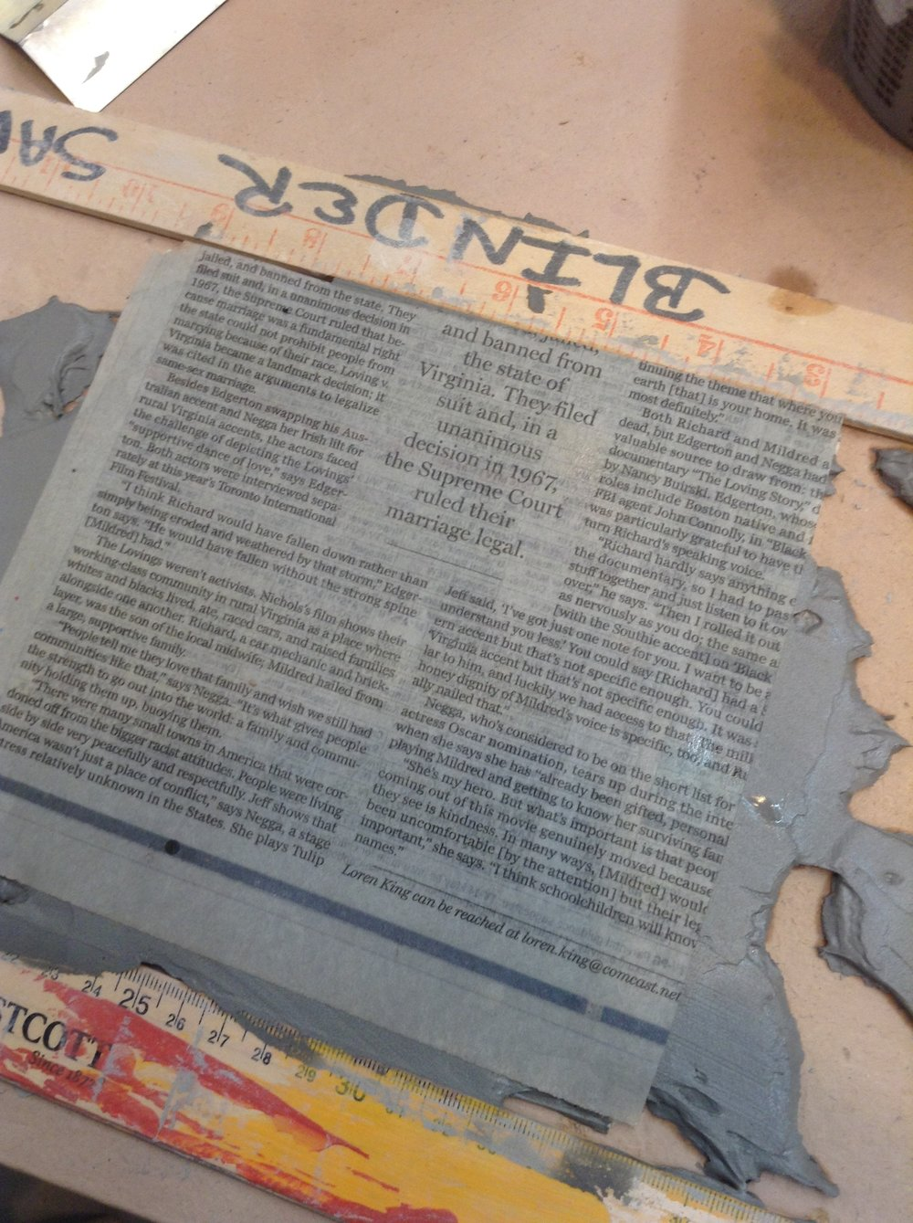 Excess size of thinly spread slip covered on second side with newspaper. Excess slip was scooped away and was perfectly usable for another project.