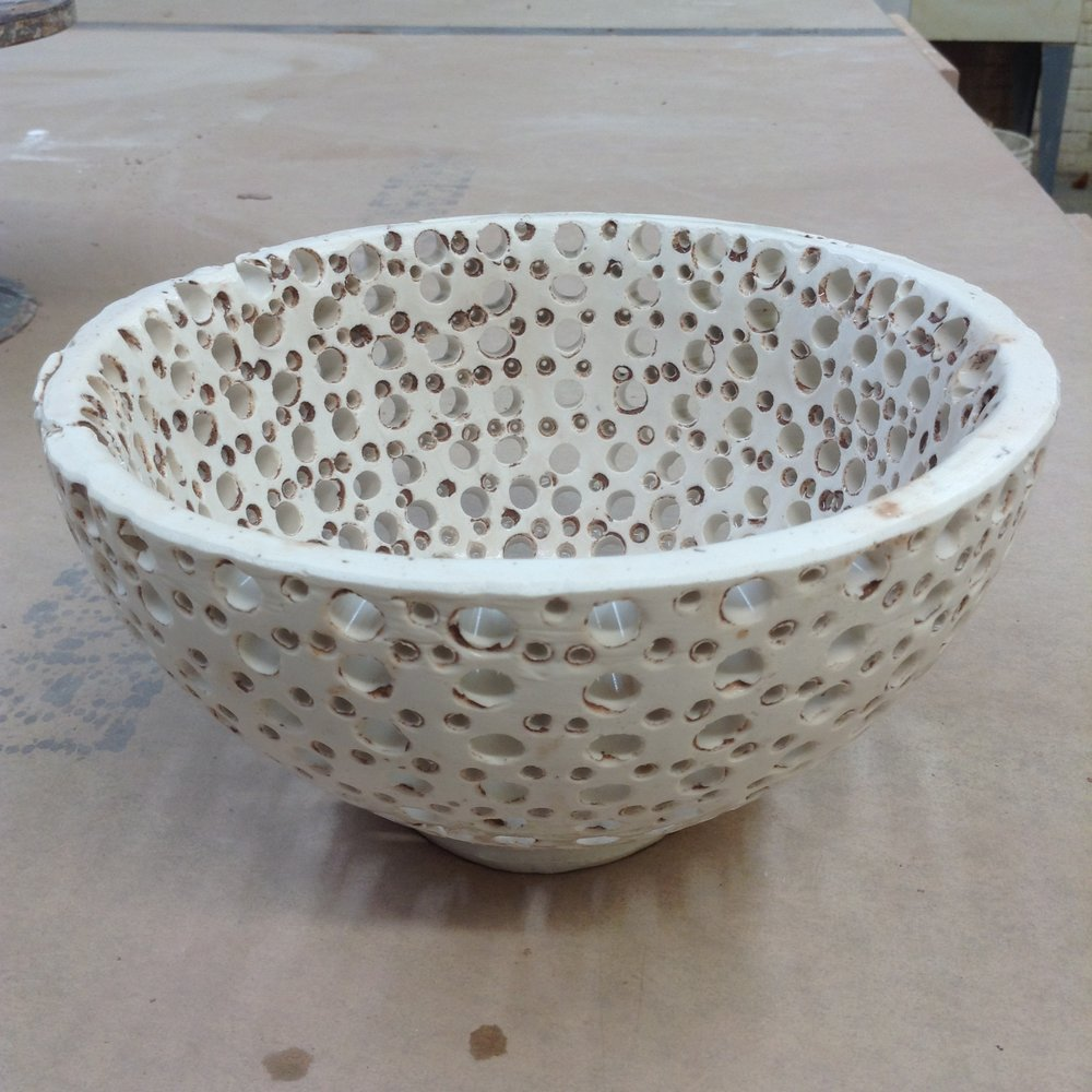 This plaster bowl is an example of using the space between two nesting clay forms.