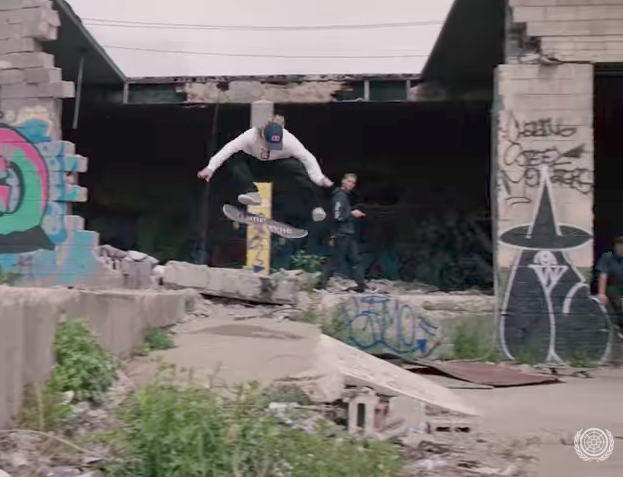Jamie Foy Kickflipping into some gnarly Detroit DIY as his homie watches.