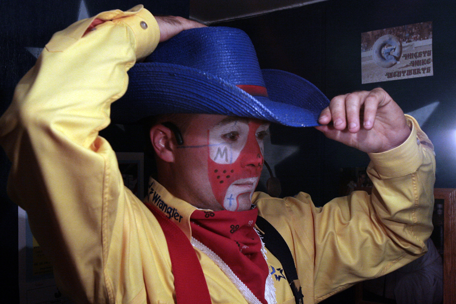 071108 Friday - Mike Wentworth puts on his cowboy hat before the rodeo on Friday. Wentworth who has been a rodeo clown for thirteen years performs across the country including about ten performances a year in and around Knoxville. His latest local performance was at the 5th annual Red Gate Festival and Rodeo that was put on by Spur-N-S Rodeo in Maynardville, TN on July 14th. (Photography by Chad Greene)