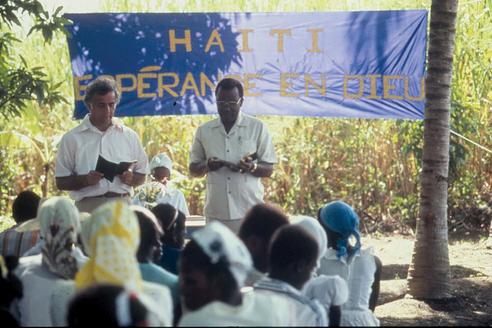 "On January 9, 1983, our first Sunday in Haiti, Pastor George DeTellis planted a church. A banner was tied between two coconut trees which read, ""Haiti, Hope in God."""