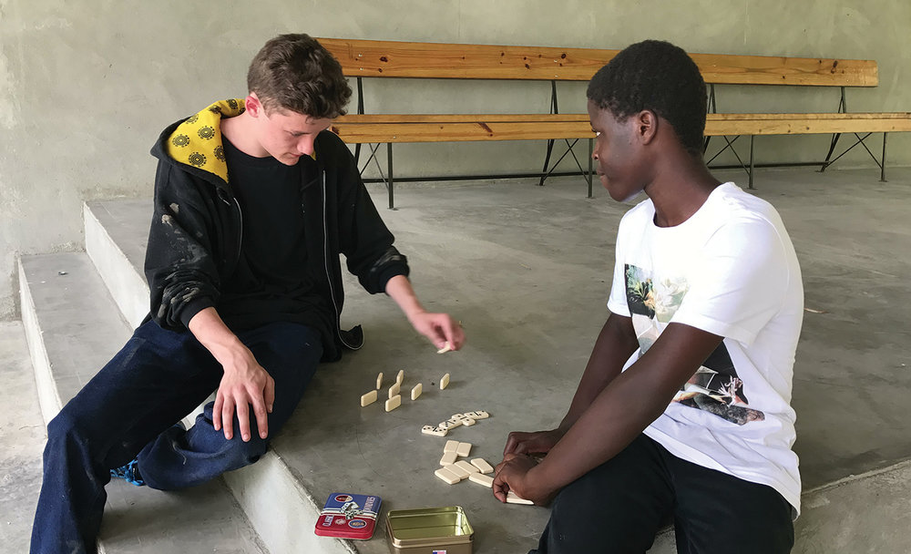 Meeting your sponsored child equals quality time to enjoy a game of Dominoes together.