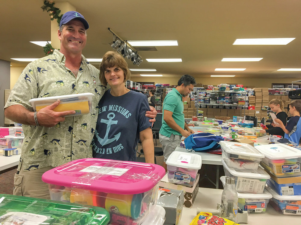 Former missionaries with New Missions, Ken and Kim Carroll, served by processing shoeboxes in Orlando. Thanks to all of our volunteers!