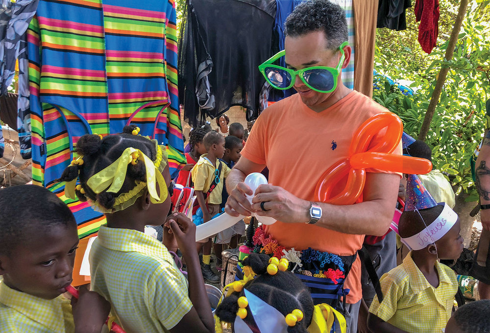 Joseph Ortiz took his balloon animal making skills to the villages.