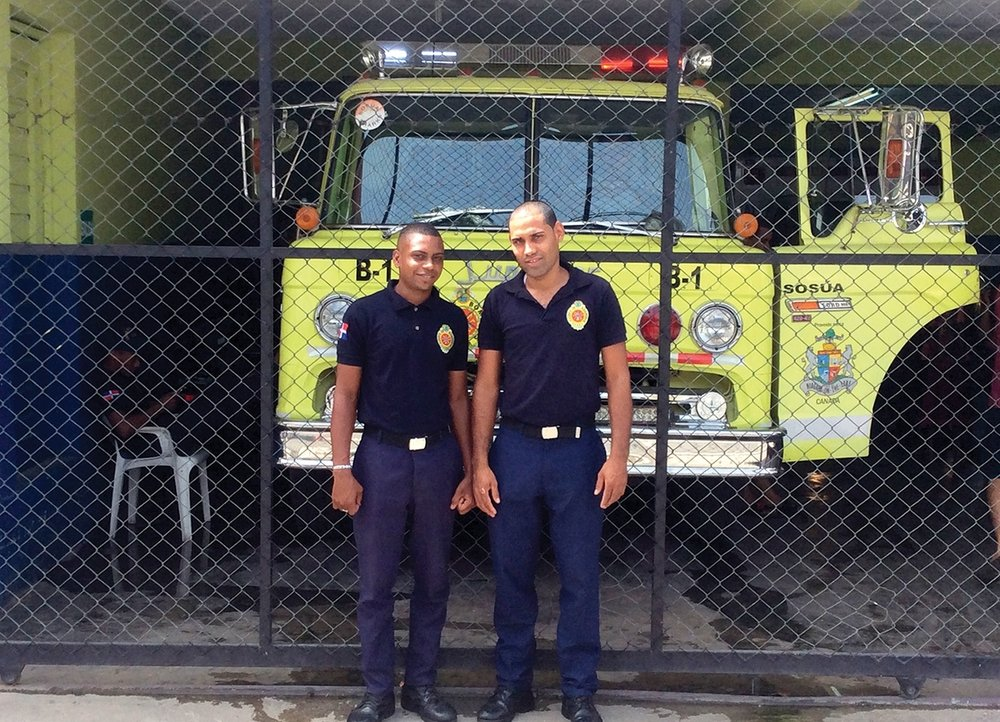 Berny Liriano and Stanli J. Geronimo, former students at our school in Redemption Village, are now firefighters.