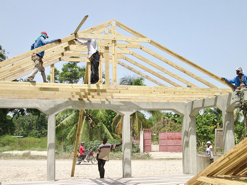 The roof trusses for our churches are made by Haitian carpenters at New Missions.