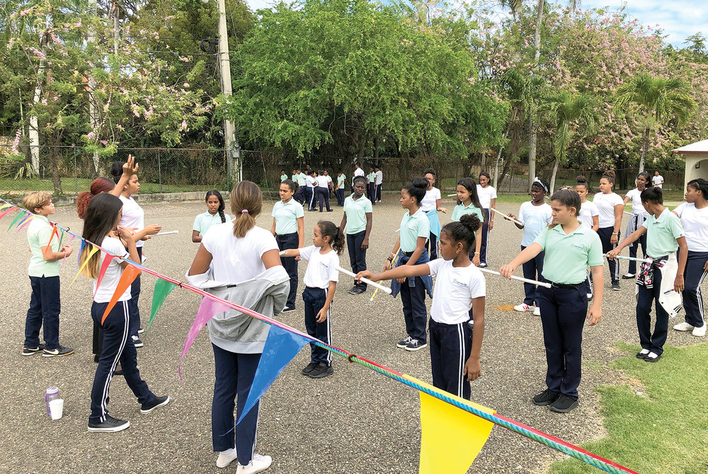 Experienced students learn leadership skills as they lead and direct new students who participate in the annual parade. As students practice marches during the month of February, they learn more about loving and respecting their country.