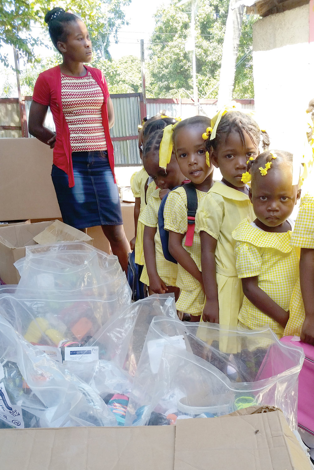 Young students from our school in Lafferonay, Haiti, line up to receive new pairs of sneakers.
