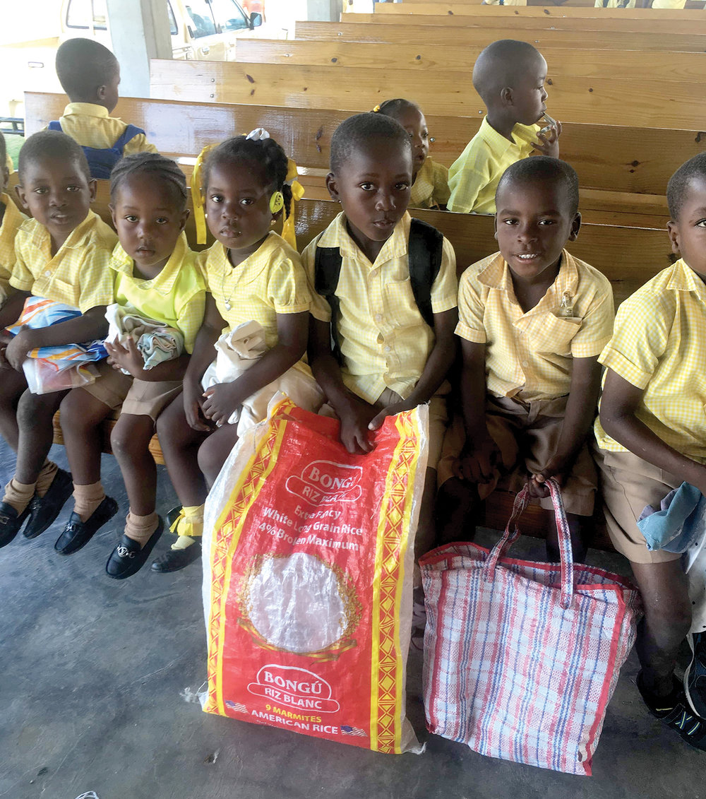 The mission team from New Port Assembly provided food for children to take home to their families.