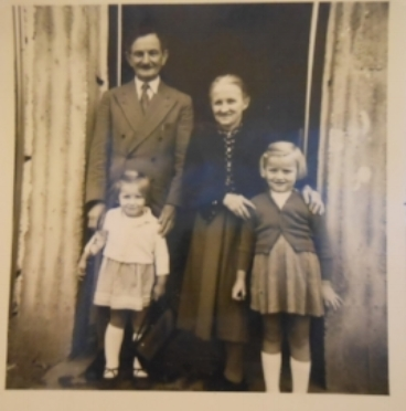 In Germany: Eva (on the right) with her younger sister and her aunt and uncle