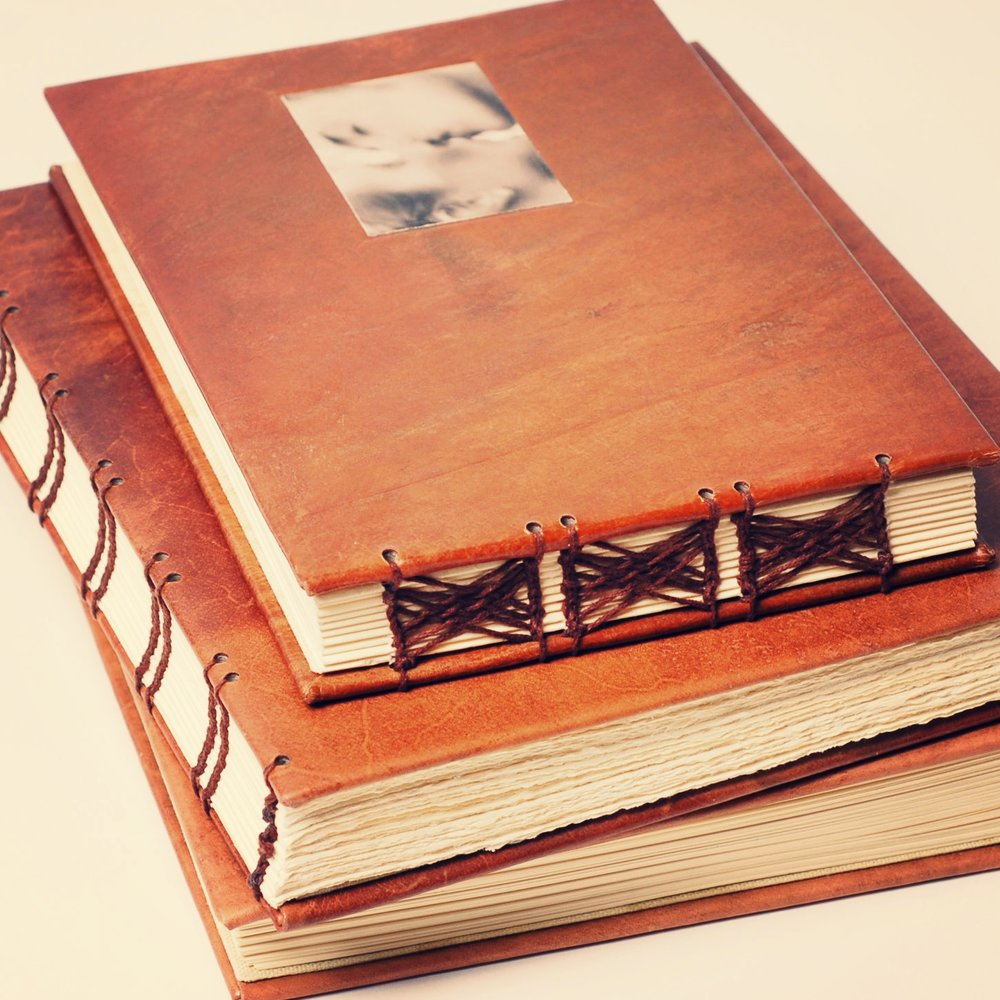 leather personal history and family history coffee table books