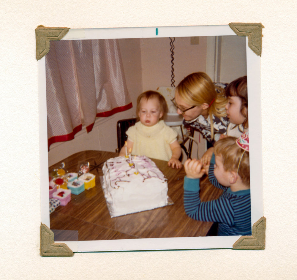 girl-blowing-out-second-birthday-candles