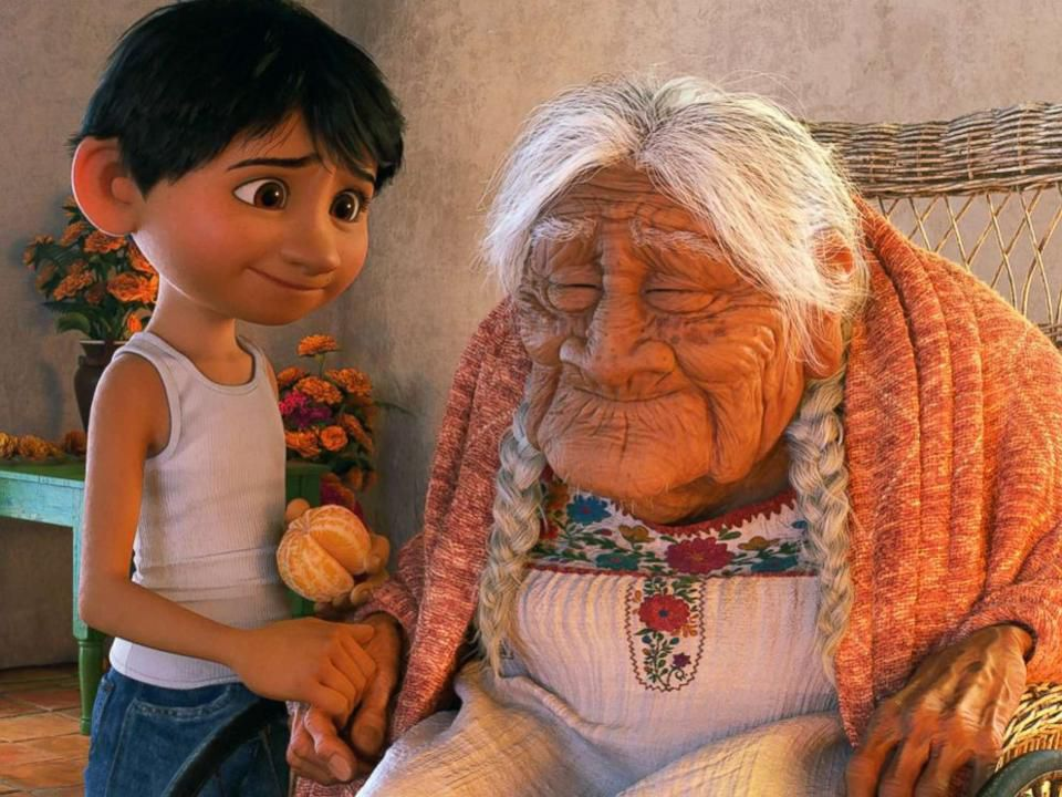 A scene from  Coco : main character Miguel with his oldest living relative, great-grandmother Mamá Coco.  Disney-Pixar