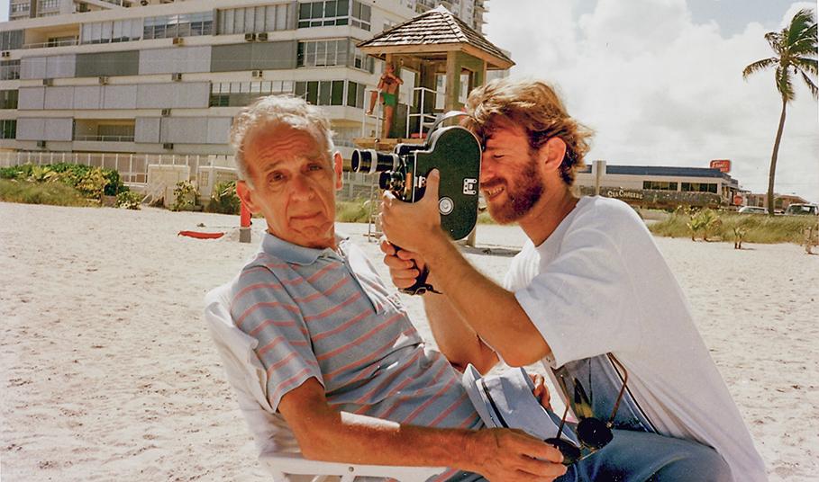 Filmmaker Alan Berliner filming his father Oscar on a Florida beach, circa 1993